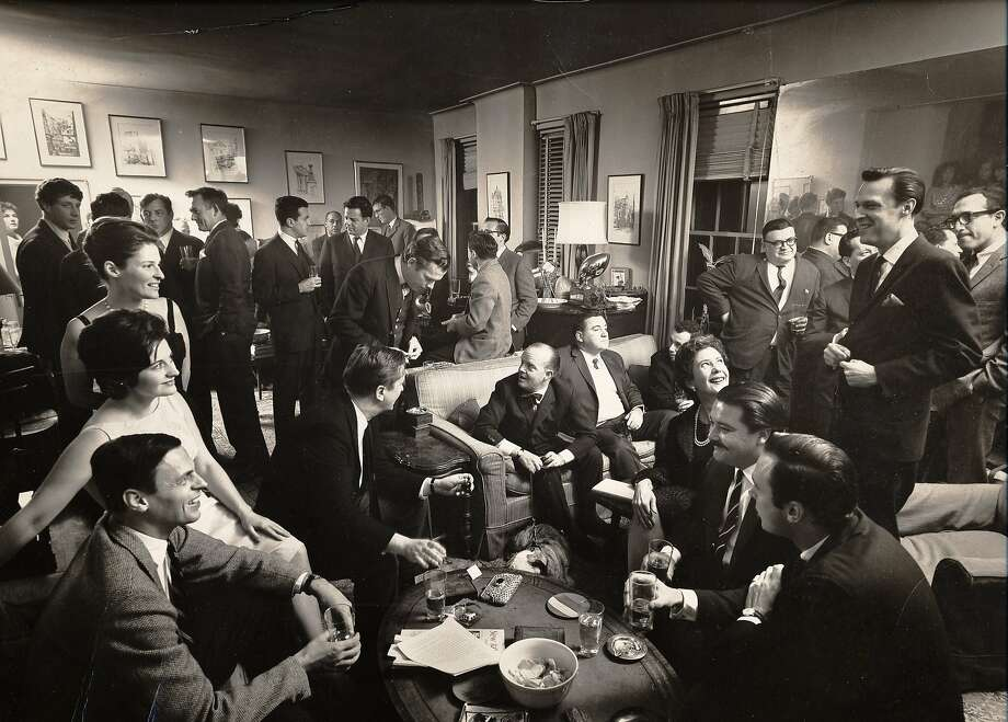 George Plimpton (bottom left) hosts a cocktail party at his apartment in 1963. Among the guests is writer Truman Capote (far left on couch). Plimpton's first wife said she found the constant parties exhausting. Photo: Cornell Capa, Laemmle Zeller Films / PBS