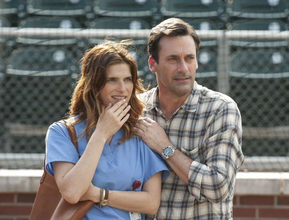 Jon Hamm as JB and Lake Bell as Brenda, JB's neighbor and friend, watch the boys pitch at USC. Photo: Ron Phillips, Walt Disney Pictures