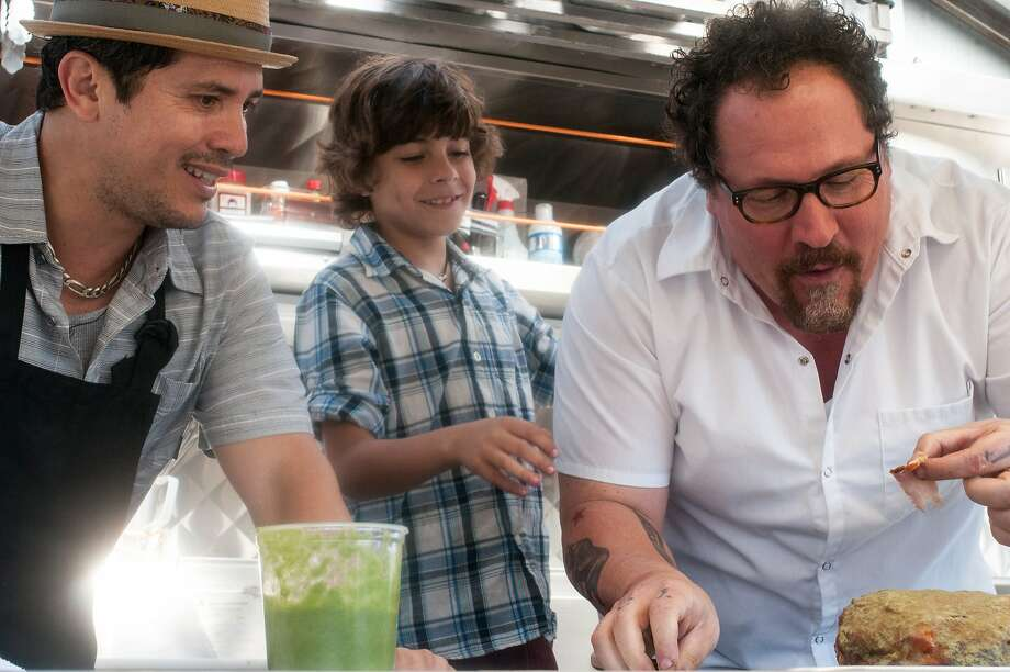 John Leguizamo as Martin, Emjay Anthony as Percy Casper, and Jon Favreau as Carl Casper in CHEF, written and directed by Jon Favreau, opening May 2014. Photo: Merrick Morton, Open Road Films