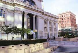 1. Oakland City Hall 1 Frank H. Ogawa Plaza: It took three years and $1.15million to build this three-tier, Beaux Arts high rise, completed in 1914. Designed by William Palmer and Henry Hornbostel, it features a white granite exterior and glazed, terracotta figs, grapes, olives and wheat symbolizing California's agricultural bounty. www2.oaklandnet.com.