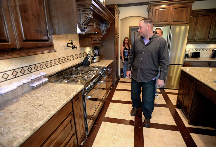 Sgt. Josh Yarbrough, walks through his kitchen for the first time Wednesday after a welcome-home celebration in Port Neches. A gift from veteran supporters and fundraisers had the home designed for wheelchair access.   Photo taken Wednesday March 14, 2014 Guiseppe Barranco/@spotnewsshooter Photo: Guiseppe Barranco, Photo Editor