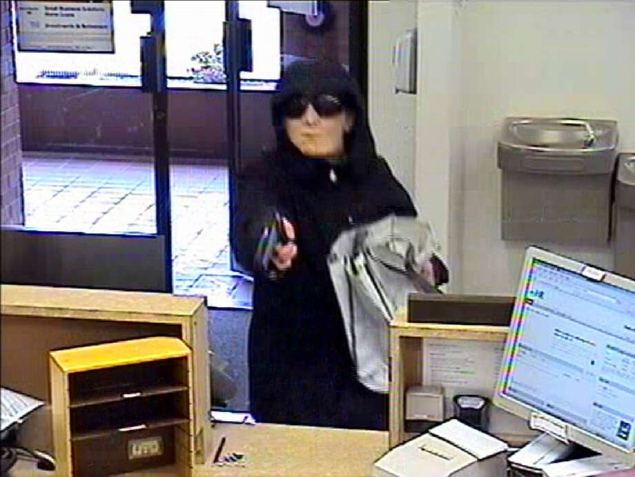 Riley Holmes, pictured during a Dec. 11, 2012, robbery of a Bank of America branch in Seattle's Magnolia neighborhood. Photo: Seattle Police Department Photo