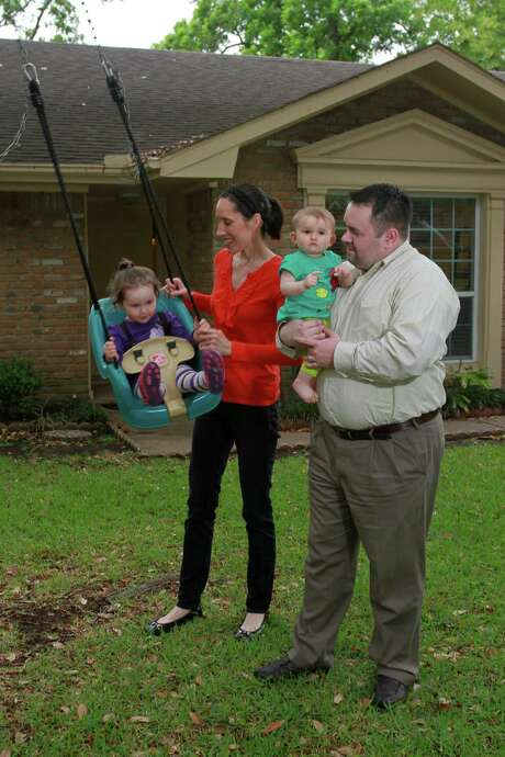 Lacey and Jason Dobrolecki and their children, Kalli, 2½, and Malina, 10 months, are renting as they wait to buy a home in Meyerland close to Jason's workplace. Photo: Gary Fountain, Freelance / Copyright 2014 by Gary Fountain