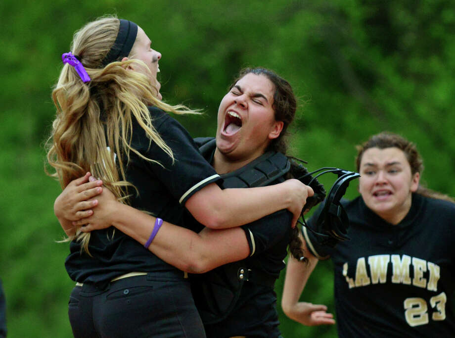 Jonathan Law's pitcherJenna Bernard, left, and catcher Amanda Leone celebrate after beating cross-town rival Foran 4-0 in the eighth inning, during softball action in Milford, Conn. on Wednesday May 14, 2014. Photo: Christian Abraham / Connecticut Post