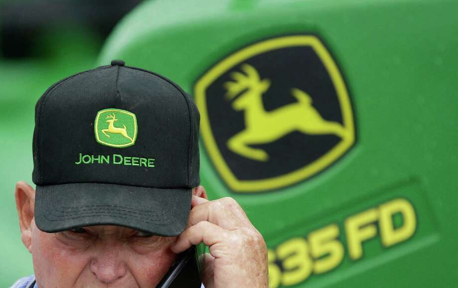 Deere & Co. cut its sales forecast for the year because of lower demand for farming equipment. Photo: Nati Harnik, STF / AP
