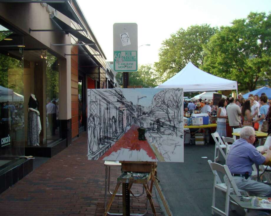 Live demonstrations by local artists will again be part of a vibrant scene downtown on Thursday evening, May 22, when a free street party kicks off Art About Town, the Downtown Merchants Association's annual three-week celebration of art. This scene is from a past Art About Town street party. Photo: Westport News/Contributed Photo / Westport News