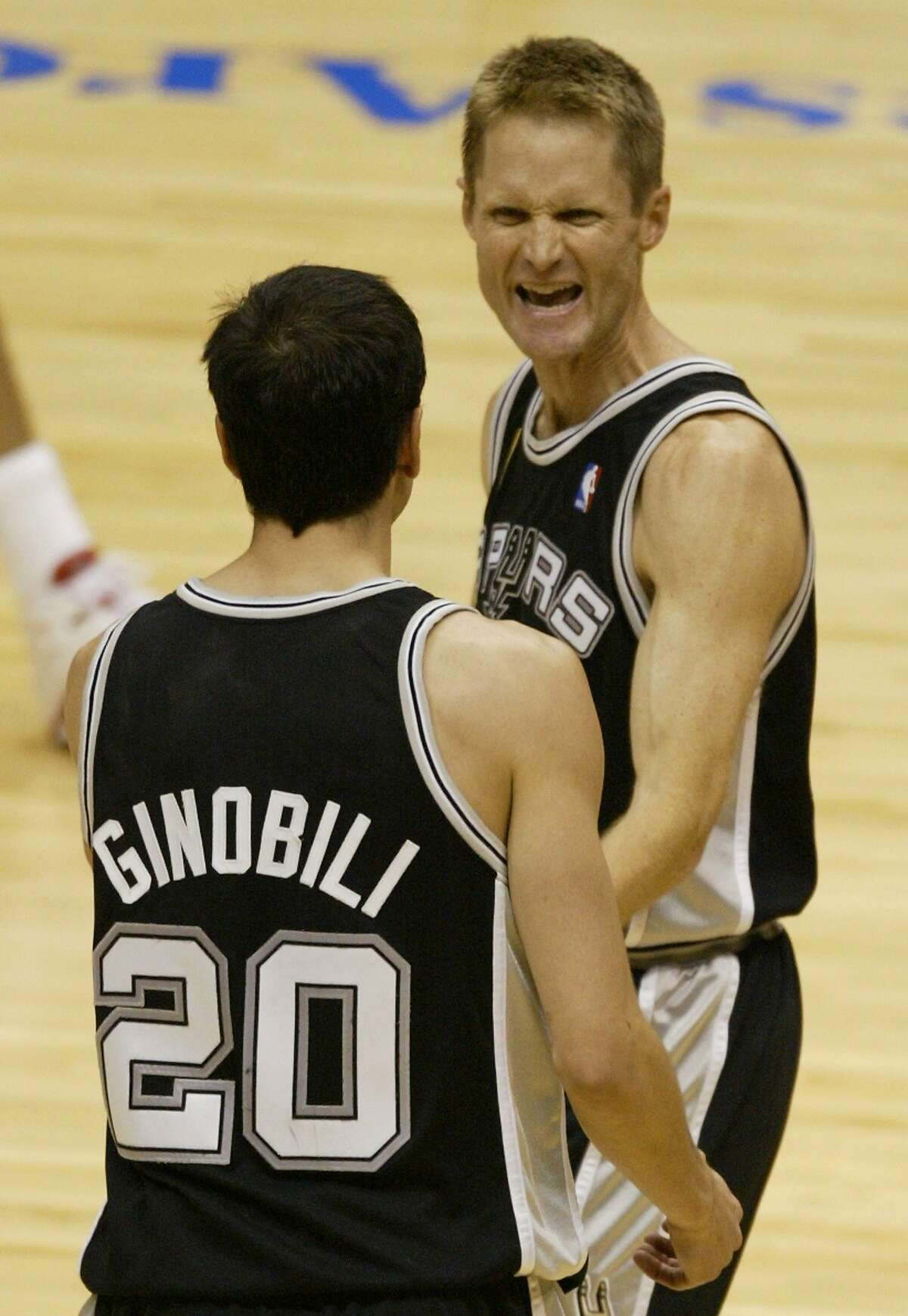 San Antonio Spurs' Steve Kerr is congratulated by teammate Emanuel Ginobili after Kerr shot a three-pointer against the New Jersey Nets in the second half of game 5 of the NBA Finals Friday June 13, 2003 in East Rutherford, N.J. The Spurs defeated the Nets 93-83. (AP Photo/Miles Kennedy)