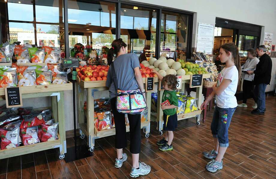 Customers enter the new Saratoga Springs Fresh Market grocery store Wednesday, May 14, 2014, on Marion Ave. in Saratoga Springs, N.Y. This is the second Fresh Market store in the Capital Region. (Lori Van Buren / Times Union) Photo: Lori Van Buren / 00026895A