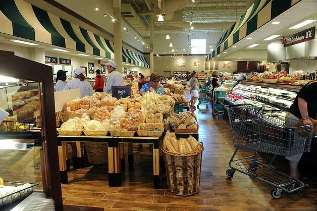 Customers shop in the new Saratoga Springs Fresh Market grocery store Wednesday, May 14, 2014, on Marion Ave. in Saratoga Springs, N.Y. This is the second Fresh Market store in the Capital Region. (Lori Van Buren / Times Union) Photo: Lori Van Buren / 00026895A