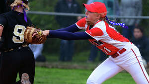 Foran's Fallon Bevino tags out Jonathan Law's Justine Bannon, during softball action in Milford, Conn. on Wednesday May 14, 2014. Jonathan Law beat their cross-town rival 4-0 in the eighth inning.