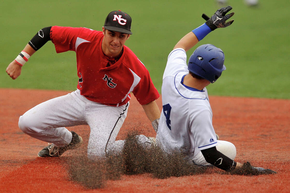 New Canaan shortstop Matt Toth catches Darien's Brendan Donohue trying to steal second base during their baseball game at Darien High School in Darien, Conn., on Wednesday, May 14, 2014. New Canaan won, 6-2.