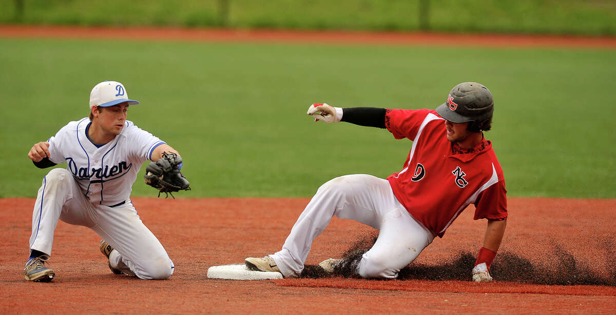 New Canaan's Nick Cascione steals second base beating the tag of Darien second baseman Brendan Donohue during their baseball game at Darien High School in Darien, Conn., on Wednesday, May 14, 2014. New Canaan won, 6-2.