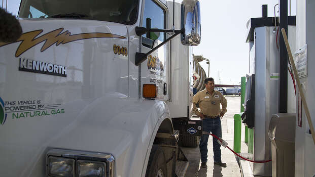 "Juan Rodriguez, a truck driver for Dillon Transport, fills his rig with compressed natural gas at a Flying J truck stop on the East Side, the first of three public natural gas stations planned for the area. Officials celebrated the opening as making San Antonio the final piece of a ""clean transportation triangle"" linking its highways with Dallas and Houston. Photo: Alma E. Hernandez / For The San Antonio Express-News"