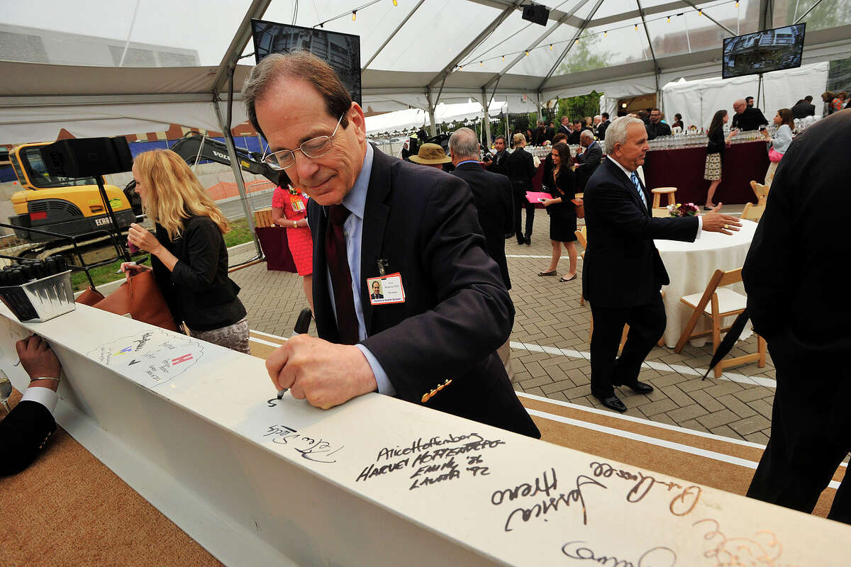 Dr. Steven Horowitz, chief cardiologist at Stamford Hospital, signs one of two steel girders during the topping off ceremony of the new wing of Stamford Hospital in Stamford, Conn., on Wednesday, May 14, 2014.