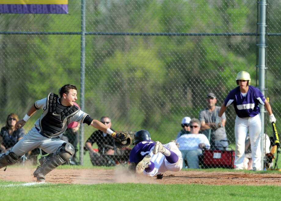 CBA's Zack Dethomasis slides home safe under the tag of Troy catcher Ben Julian during their boy's high school baseball game on Wednesday May 14, 2014 in Colonie, N.Y. (Michael P. Farrell/Times Union) Photo: Michael P. Farrell / 00026892A