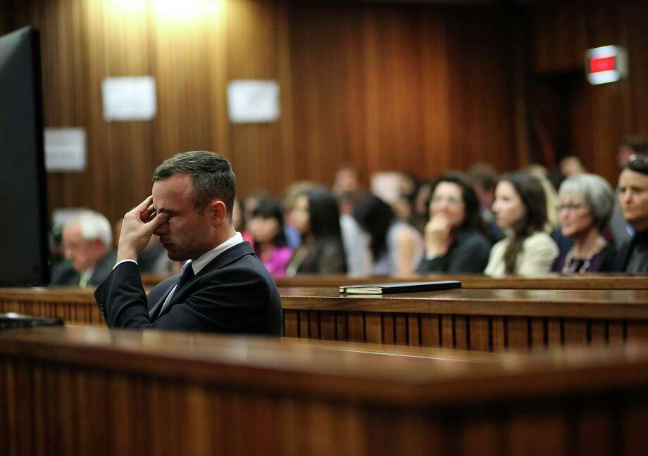 The Pretoria, South Africa, trial of Oscar Pistorius, charged with murdering his girlfriend, will be delayed as Pistorius undergoes psychiatric examination. Photo: Siphiwe Sibeko / Associated Press / REUTERS POOL