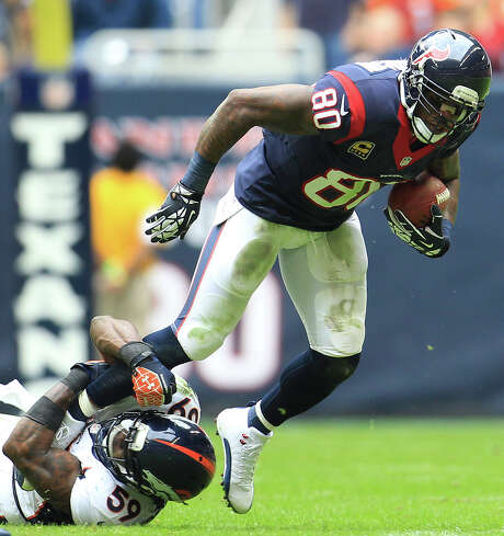 Andre Johnson makes one of his 109 catches in 2013, a total that was the third highest of his career. Photo: Karen Warren, Staff / © 2013 Houston Chronicle
