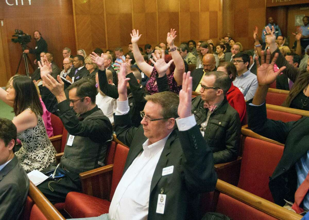 Backers react at City Hall on Wednesday. The law would consolidate bans on discrimination and boost protection for gay and transgender residents.