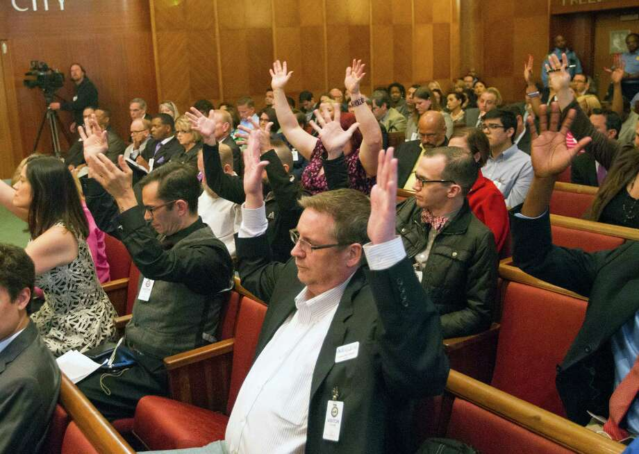 Backers react at City Hall on Wednesday. The law would consolidate bans on discrimination and boost protection for gay and transgender residents. Photo: Cody Duty, Staff / © 2014 Houston Chronicle
