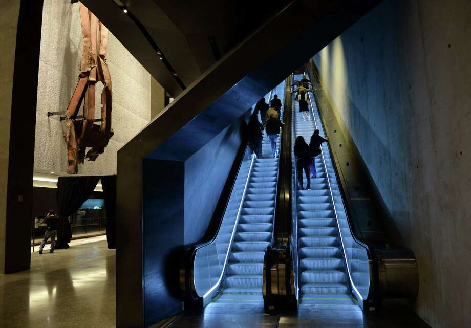 Escalators going up to street level past a section of steel facade from the North Tower, floors 96 to 99, (L) seen during a press preview in the National September 11 Memorial Museum at the World Trade Center site May 14, 2014 in New York. Photo: STAN HONDA, AFP/Getty Images / AFP