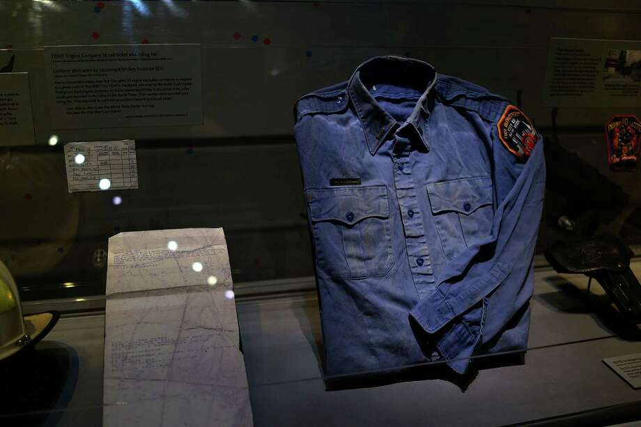A firefighters shirt used at Ground Zero on September 11 is viewed during a tour the National September 11 Memorial Museum on May 14, 2014 in New York City. Photo: Spencer Platt, Getty Images / 2014 Getty Images
