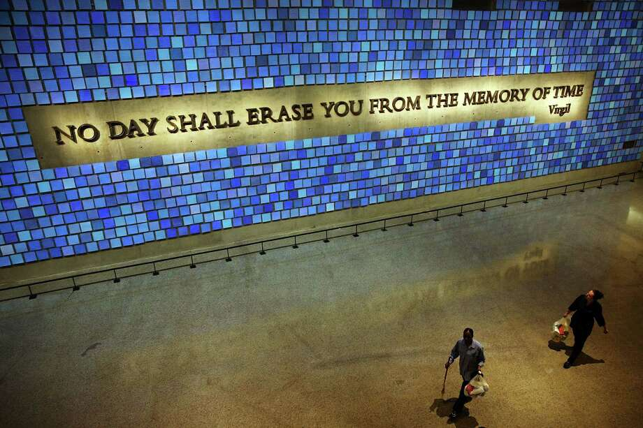 A wall with a quote from Virgil and featuring 2,983 panels for each victim is viewed during a tour of the National September 11 Memorial Museum on May 14, 2014 in New York City. Photo: Spencer Platt, Getty Images / 2014 Getty Images