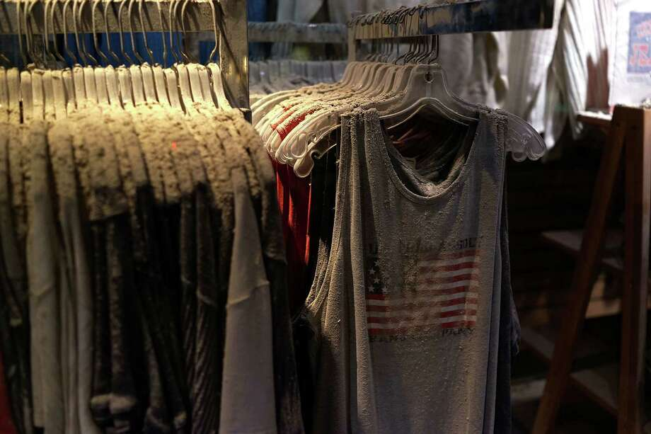 Dust, ash and debris from the collapsed Twin Towers are viewed on the clothes from the store Chelsea Jeans in an exhibit at viewed during a preview of the National September 11 Memorial Museum on May 14, 2014 in New York City. Photo: Spencer Platt, Getty Images / 2014 Getty Images