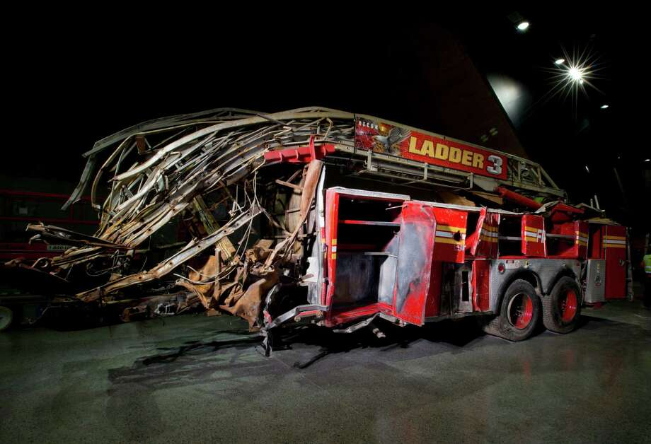 In this May 5, 2014 photo released by the National September 11 Memorial Museum, a firetruck, damaged in the attacks of September 11, 2001, is on display at the New York museum. Photo: Jin Lee, Associated Press / AP