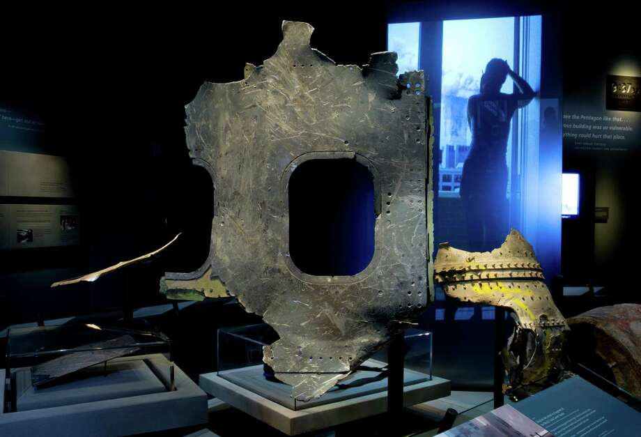 In this May 5, 2014 photo released by the National September 11 Memorial Museum, a piece of airplane damaged in the attacks of September 11, 2001, is displayed at the New York museum. The long-delayed museum will be dedicated during a ceremony Thursday, May 15, 2014. Photo: Jin Lee, Associated Press / AP