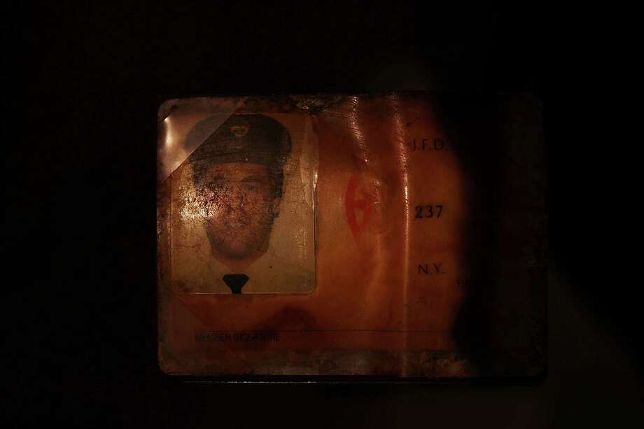 The personal identification of Glenn J. Winuk, who was killed at Ground Zero on September 11, is viewed during a tour the National September 11 Memorial Museum on May 14, 2014 in New York City. Photo: Spencer Platt, Getty Images / 2014 Getty Images