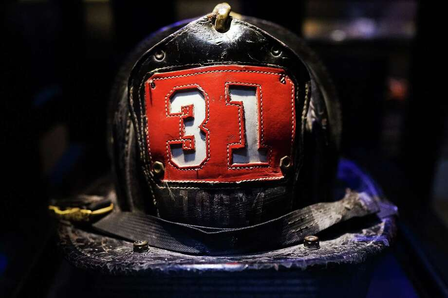 Surviving firefighter Dan Potter's fire helmet, which he used at Ground Zero on September 11, is viewed during a tour the National September 11 Memorial Museum on May 14, 2014 in New York City. Photo: Spencer Platt, Getty Images / 2014 Getty Images
