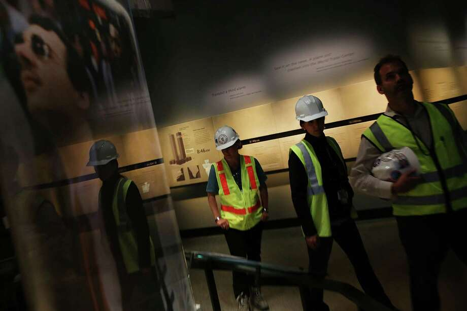 Port Authority workers tour the National September 11 Memorial Museum on May 14, 2014 in New York City. Photo: Spencer Platt, Getty Images / 2014 Getty Images