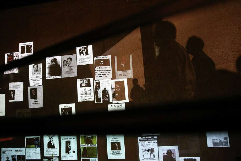 Handmade missing posters of victims of September 11 are viewed during a tour of the National September 11 Memorial Museum on May 14, 2014 in New York City. Photo: Spencer Platt, Getty Images / 2014 Getty Images