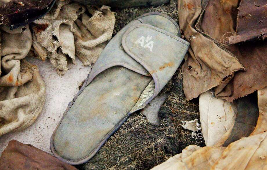 This file photo of June 19, 2011 shows an American Airlines slipper stored in Hangar 17 at John F. Kennedy International Airport in New York. The slipper is an artifact from the Sept. 11, 2001 attacks that is to be part of the National September 11 Memorial Museum, which will be dedicated Thursday, May 15, 2014, in a ceremony attended by President Barack Obama. Photo: Mark Lennihan, Associated Press / AP