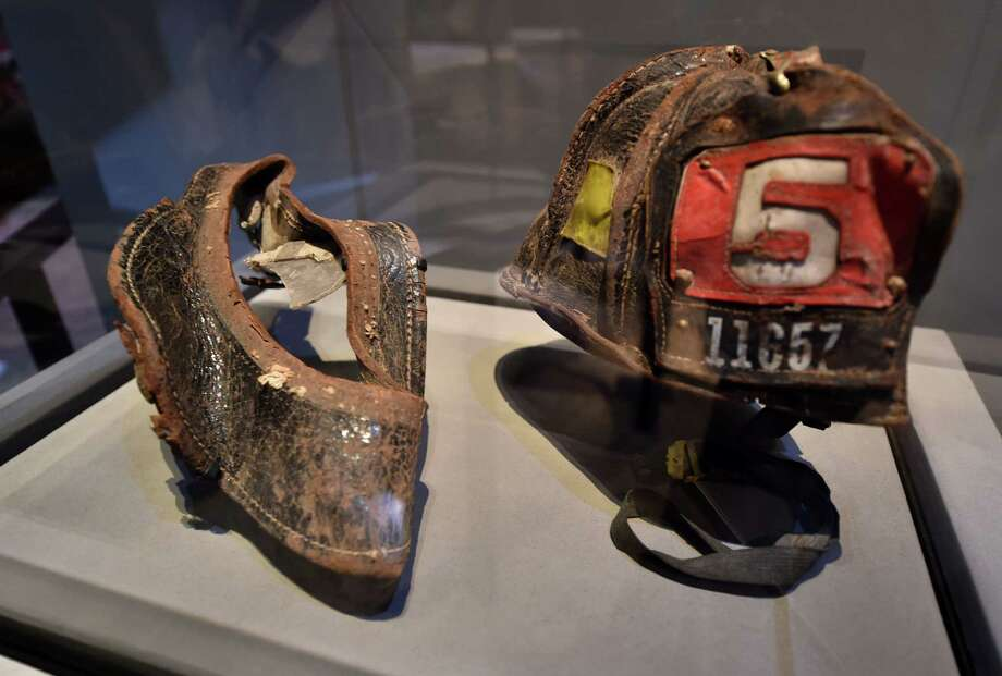 HelmetS worn by New York City Fire Department Firefighter Christian Waugh on September 11, 2001, are seen during a press preview of the National September 11 Memorial Museum at the World Trade Center site May 14, 2014 in New York. Photo: STAN HONDA, AFP/Getty Images / AFP