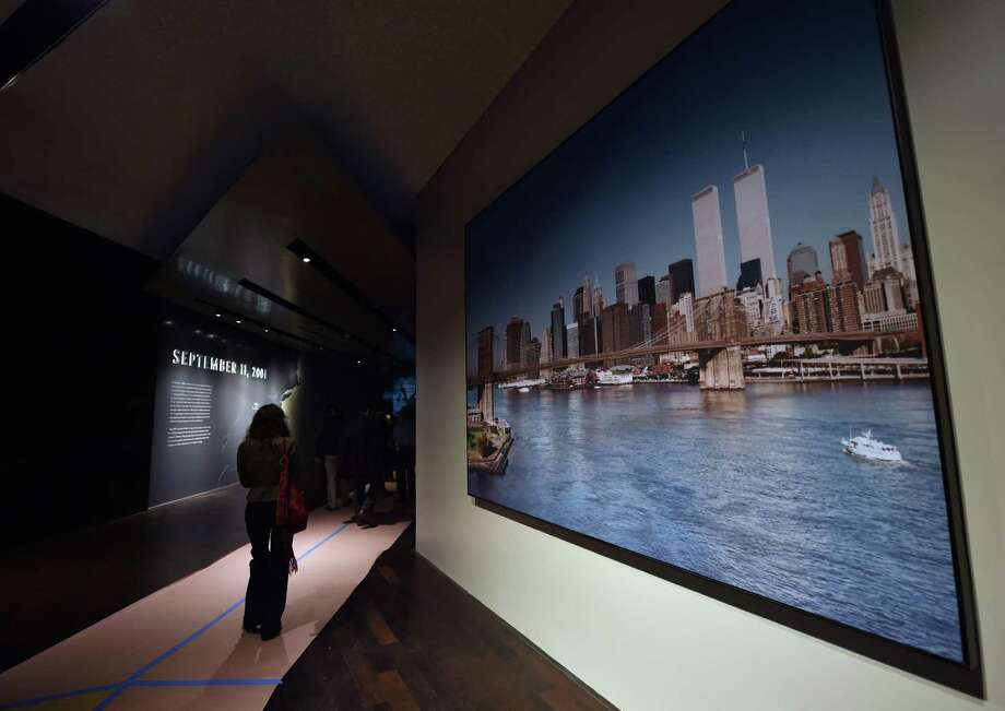 A photograph of the World Trade Center twin towers(R) is seen during a press preview of the National September 11 Memorial Museum at the World Trade Center site May 14, 2014 in New York. Photo: STAN HONDA, AFP/Getty Images / AFP