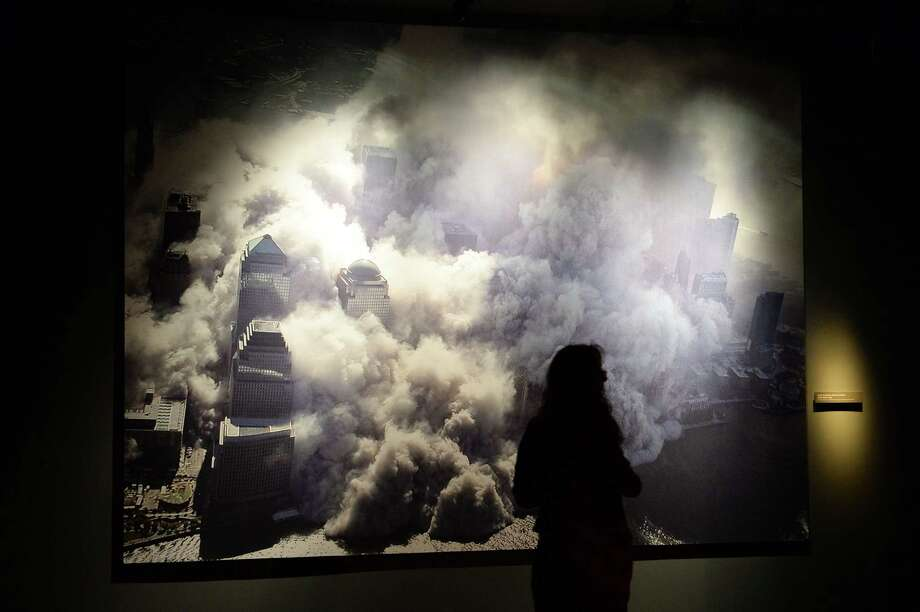 A photograph of one of the World Trade Center towers collapsing after the September 11, 2001 attack, seen during a press preview of the National September 11 Memorial Museum at the World Trade Center site May 14, 2014 in New York. Photo: STAN HONDA, AFP/Getty Images / AFP