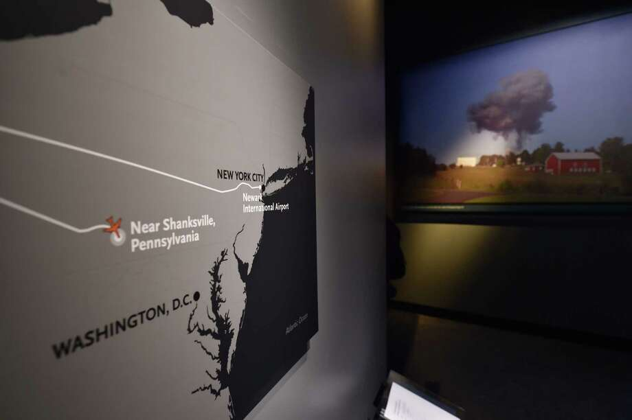 An exhibit about the plane that crashed near Shanksville, Pennsylvania on September 11, 2001 and a photograph of the plane crash (R), seen during a press preview of the National September 11 Memorial Museum at the World Trade Center site May 14, 2014 in New York. Photo: STAN HONDA, AFP/Getty Images / AFP