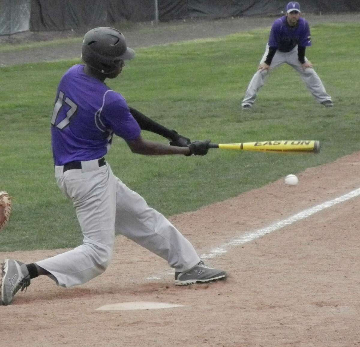 Westhill junior left fielder Dave Lauture smacks a double down the left field line in the top of the second inning on Wednesday, May 14 in an FCIAC baseball game at Kiwanis Field in Fairfield. Ludlowe defeated the Vikings 4-3 in the bottom of the seventh inning.