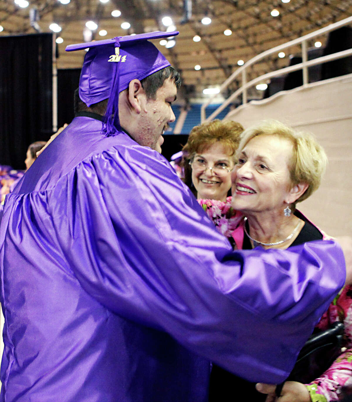 Dylan Barrera gets a hug from Northwest Vista College president Jackie Claunch before graduation begins for Northwest Vista College Wednesday May 14, 2014. Barrera graduated with his Associate of Arts degree after surviving a severe type of Leukemia and was acknowledged by Claunch during the ceremony. Barrera struggled with his classes after starting in 2010 while also undergoing chemotherapy. While going through chemo and classes Northwest Vista College organized a blood drive for Barrera.