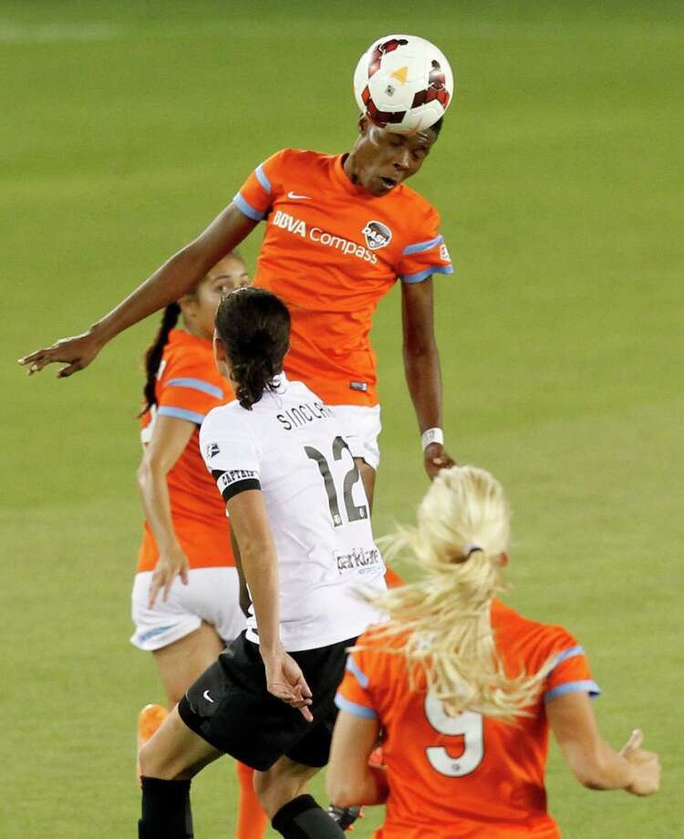 Houston Dash Osinachi Ohale (20) heads the ball over Portland Thorns  Christine Sinclair (12)in the second half on May 14, 2014 at BBVA Compass Stadium in Houston, TX. Portland won 1 to 0. Photo: Thomas B. Shea, For The Chronicle / © 2014 Thomas B. Shea