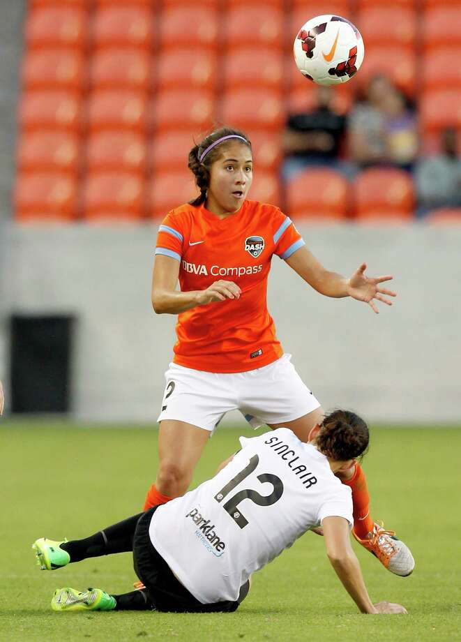 Houston Dash Arianna Romero (2) heads the ball away from Portland Thorns Christine Sinclair (12) in the first half on May 14, 2014 at BBVA Compass Stadium in Houston, TX. Portland won 1 to 0. Photo: Thomas B. Shea, For The Chronicle / © 2014 Thomas B. Shea