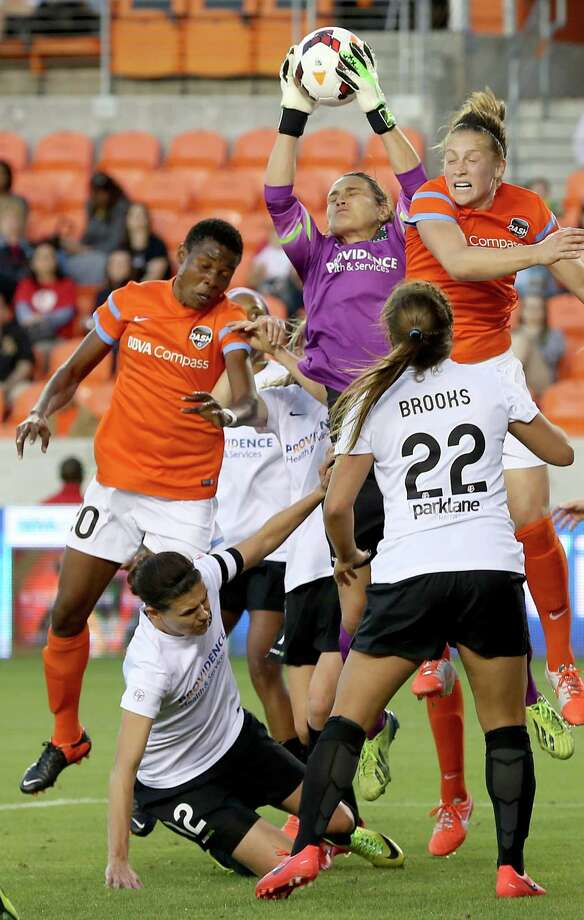 Houston Dash Osinachi Ohale (20) tries to head the ball while Portland Thorns goal keeper Nadine Angerer (1) grabs a corner kick in the first half on May 14, 2014 at BBVA Compass Stadium in Houston, TX. Portland won 1 to 0. Photo: Thomas B. Shea, For The Chronicle / © 2014 Thomas B. Shea