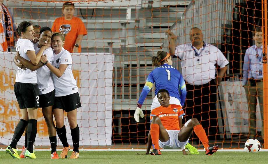 Portland Thorns Jessica McDonald (14) celebrates her goal with teammates against Houston Dash goal keeper Erin McLeod (1) and defender Osinachi Ohale (20) in the second half on May 14, 2014 at BBVA Compass Stadium in Houston, TX. Portland won 1 to 0. Photo: Thomas B. Shea, For The Chronicle / © 2014 Thomas B. Shea