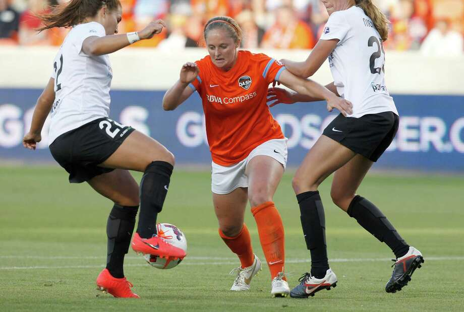 Houston Dash Jordan Jackson (8) charges Portland Thorns Amber Brooks (22) in the first half on May 14, 2014 at BBVA Compass Stadium in Houston, TX. Portland won 1 to 0. Photo: Thomas B. Shea, For The Chronicle / © 2014 Thomas B. Shea