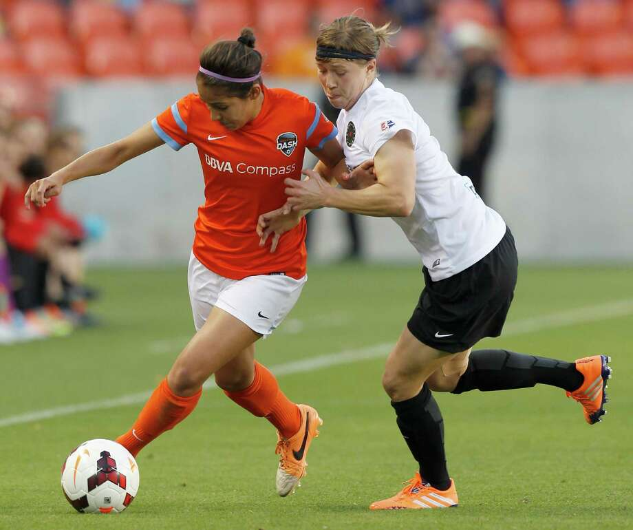 Houston Dash Arianna Romero (2) fights off a Portland Thorns Emily Menges (21) in the first half on May 14, 2014 at BBVA Compass Stadium in Houston, TX. Portland won 1 to 0. Photo: Thomas B. Shea, For The Chronicle / © 2014 Thomas B. Shea