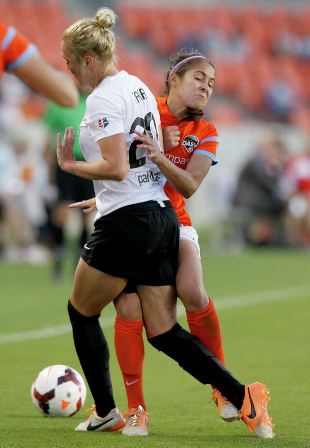 Houston Dash Arianna Romero (2) collides with Portland Thorns Kat Tarr (20) in the first half on May 14, 2014 at BBVA Compass Stadium in Houston, TX. Portland won 1 to 0. Photo: Thomas B. Shea, For The Chronicle / © 2014 Thomas B. Shea
