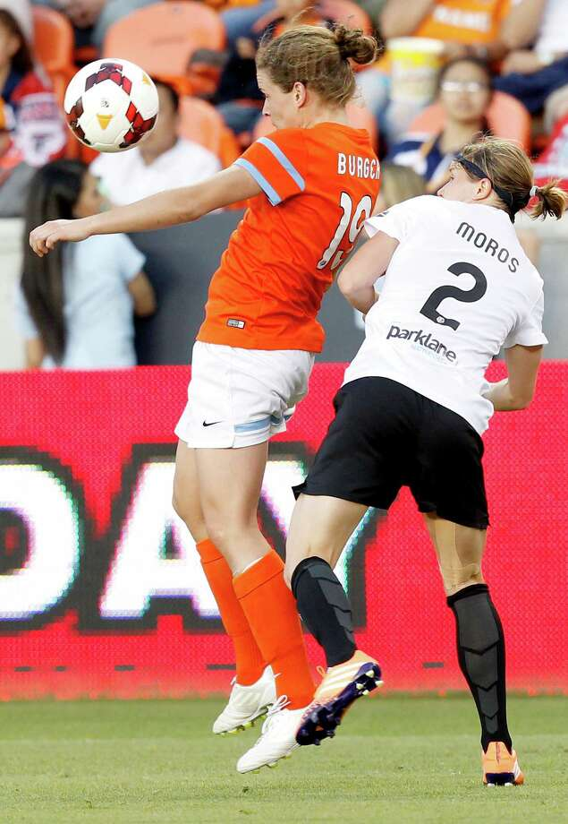Houston Dash Nina Burger (19) traps the ball away from Portland Thorns Rebecca Moros (2) in the first half on May 14, 2014 at BBVA Compass Stadium in Houston, TX. Portland won 1 to 0. Photo: Thomas B. Shea, For The Chronicle / © 2014 Thomas B. Shea