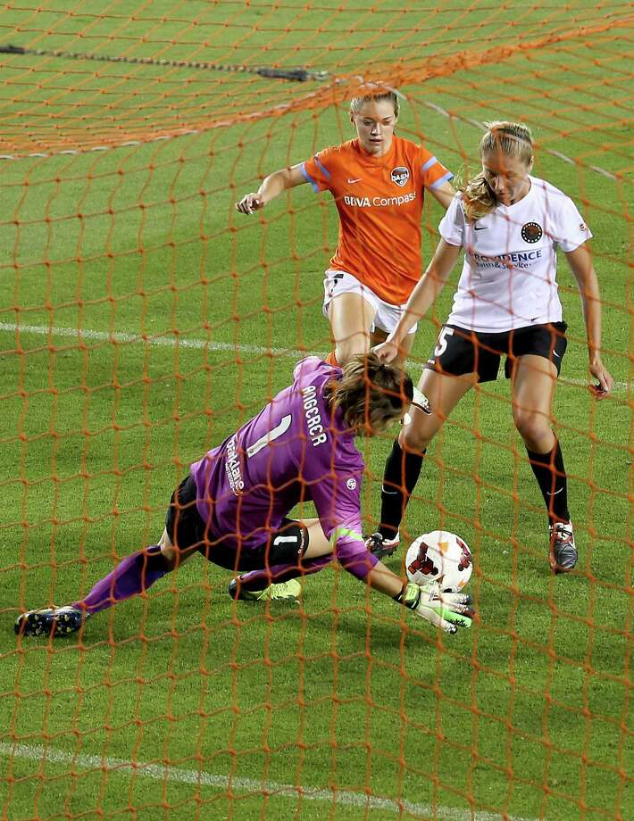 Houston Dash Kealia Ohai (7) strikes the ball in the box while Portland Thorns goal keeper Nadine Angerer (1) makes a save in the second half on May 14, 2014 at BBVA Compass Stadium in Houston, TX. Portland won 1 to 0. Photo: Thomas B. Shea, For The Chronicle / © 2014 Thomas B. Shea