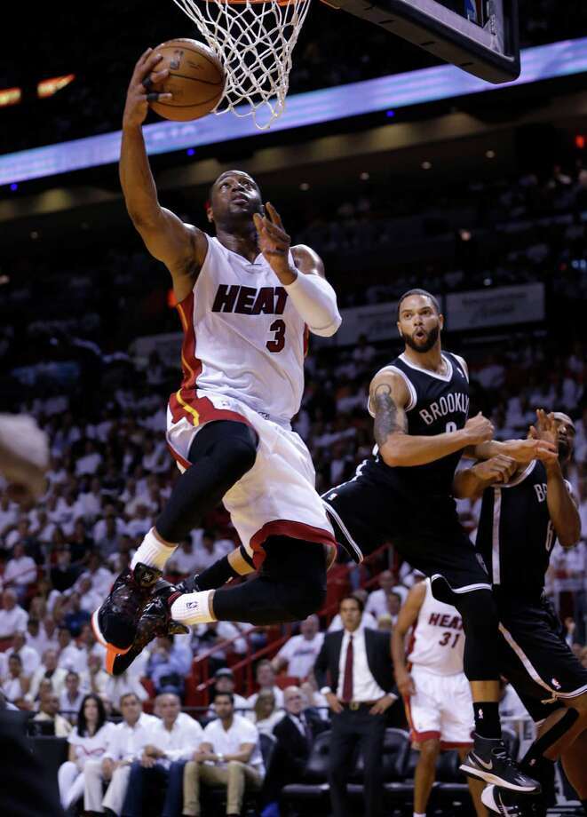 Miami Heat guard Dwyane Wade (3) goes to th basket against the Brooklyn Nets during the first half of Game 5 of a second-round NBA playoff basketball game in Miami, Wednesday, May 14, 2014. (AP Photo) ORG XMIT: AAA102 / AP